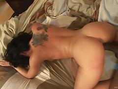 Tattooed brunette gets nailed doggystyle by big black cock in interracial clip tube porn video