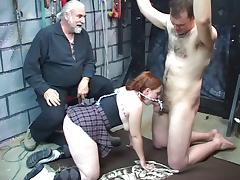 Young redhead blindfolds her victim and sucks on his little dick in basement tube porn video