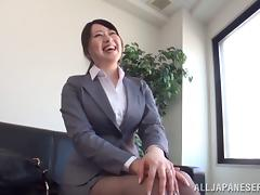 A pretty Japanese businesswoman gets her pussy toyed in the office tube porn video
