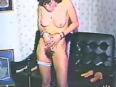 Amateur brunette mom plays with a dildo in retro homemade solo tube porn video