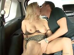 Blonde babe with huge natural tits enjoying a hardcore fuck in a car tube porn video