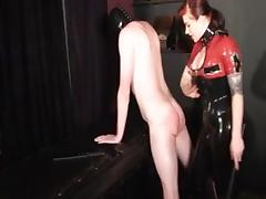 Redhead dominatrix in latex tortures her thrall tube porn video