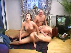 Mature redhead and her best friend are into hardcore swinger action tube porn video