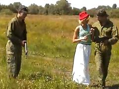 Soldiers tag team a chick while on patrol in a field tube porn video
