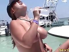 Alluring babes go topless in an out of control boat party tube porn video