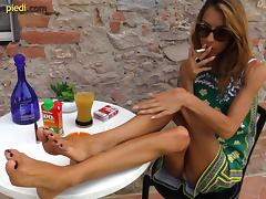 Smoking Italian girl models her pretty feet in close up tube porn video