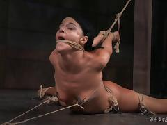 Flexible dark-haired chick penetrated with a toy in a hard BDSM play tube porn video