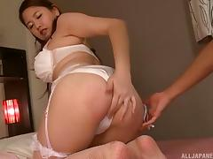 Sexy Asian babe rubs her clit before riding a massive rod tube porn video