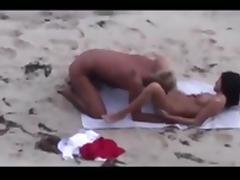 Blond guy fucks brunette on beach tube porn video