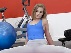 Gorgeous blonde spreads her legs after a workout for a hunk tube porn video