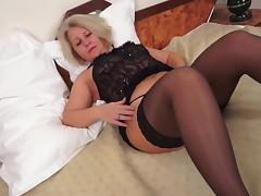 Hot blonde granny in stockings likes fingering her wet pussy tube porn video