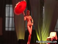 Hot busty stripper posing with umbrella tube porn video