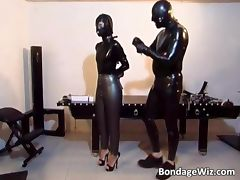 Horny slut gets in latex suit to suck tube porn video