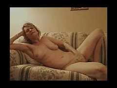 Blonde mature masturbating Blonde mature lady masturbates while laying in the sofa she looks so rela tube porn video