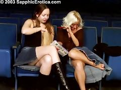 Two horny babes get naughty in the cinema tube porn video