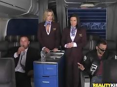 Two stewardesses get fucked by two business class passengers tube porn video