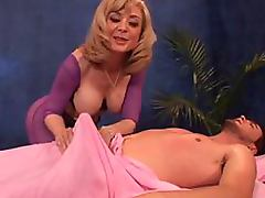 Busty Blonde Mature Nina Hartley Gives Guy a Massage and a Blowjob tube porn video