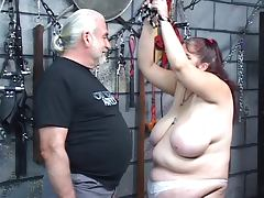 Heavy titted fat bdsm brunette gets caned and whipped by master tube porn video