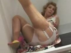 Mature Blonde lady in stockings strips in the kitchen tube porn video