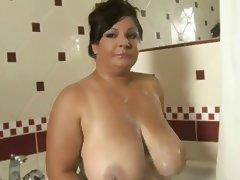 Big mature in shower tube porn video