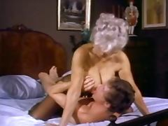 Hot mature with nice tits gets fucked by John Holmes and his legendary cock tube porn video
