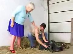 Lewd granny Cecilia gets her cunt and ass fucked in a barn tube porn video