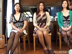Three horny Japanese women have fun with a guy in a kitchen tube porn video