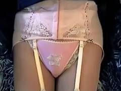 Girdle videos. Lady is showing off her white girdle and polkadot panties