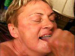 A fat old grandmother kneels and services a stiff cock tube porn video
