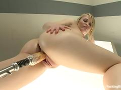 Ash Hollywood gets her coochie ripped apart by a fucking machine tube porn video