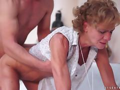 Granny makes out with a horny stud before taking his dick in her cunt tube porn video