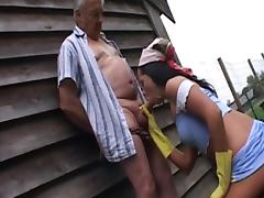 Slutty brunette wearing yellow gloves fucks with an old man tube porn video