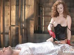 Curly-haired mistress Audrey Hollander enjoys anal sex in a shed tube porn video