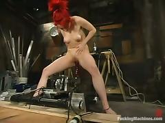 Sabrina Sparx moans crazily while riding a sex machine in a cellar tube porn video