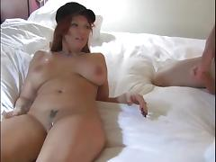 Redhead blows him, puts a condom and rides his dick tube porn video
