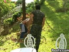 A guy in military uniform fucks a civilian guy in a park tube porn video