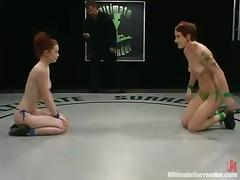 Two redhead chicks have wild sex using strap-on in a ring tube porn video