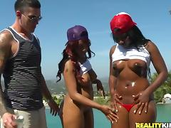 Two big-assed ebony bitches share a white dick on the patio tube porn video