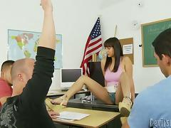Three dudes are fucking that sexy teacher in the class tube porn video