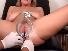 A doll and a monster speculum both in her pussy-wow! tube porn video