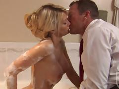 Jessica Drake gives a blowjob and gets banged in a bathroom tube porn video