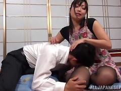 Mature Asian housewife Emiko Ejima gives dominating footjob tube porn video