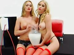 Stunning babes are playing with milk tube porn video