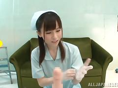 A cute Japanese nurse in gloves gives a handjob in a POV video tube porn video