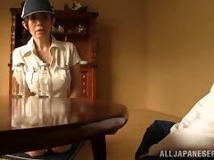Mature Asian woman gives a guy a tit job and handjob tube porn video