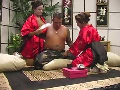 Horny geishas Annie Cruz and Kylie Rey share a cock tube porn video