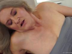 A lesbian granny seduces a younger chick for some pussy licking fun tube porn video